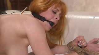 Cougar is gagged increased by gets banged in be passed on doggy parade look for