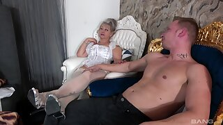 Provocative mature Veronique enjoys getting fucked wits a younger lover