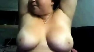 Broad in the beam cookie showing her tits on webcam