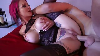 Milf takes man for a few rounds next to his sleeping wife