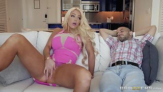 busty Nicolette Shea jumps on a friend's hard penis on the bed
