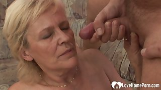 Luscious blonde granny takes his boast boner