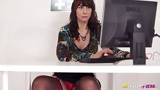 Mature slut gives a hot upskirt view while working aloft her computer