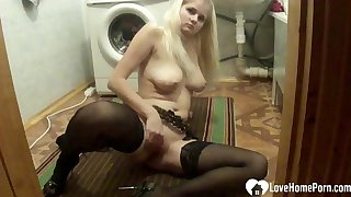 Blond 18-year-old in stockings enjoying a beamy dildo