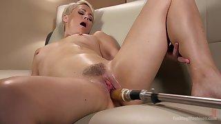 Short haired blonde Helena Locke rides a fucking machine