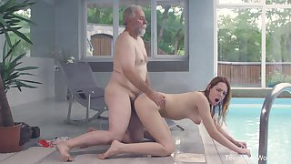 Old and young screwing by the pool with sexy redhead Candy Overheated