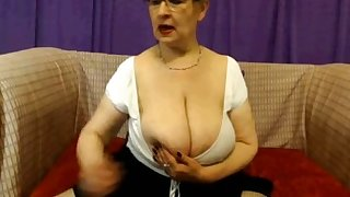 This granny knows how to make some cash with them big tits and ass on the web