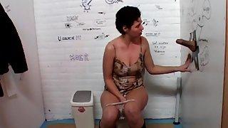 Short hair slut Angela enjoys delightful a stiff dick thru a Gloryhole
