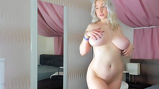 Busty, Blonde Plumper Is Naked And Playing With Her Milk Jugs, In Front Be fitting of The Camera